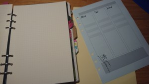 Filofax with dotted paper and homemade dividers, and week plan with columns for Mon/Tue/Wed